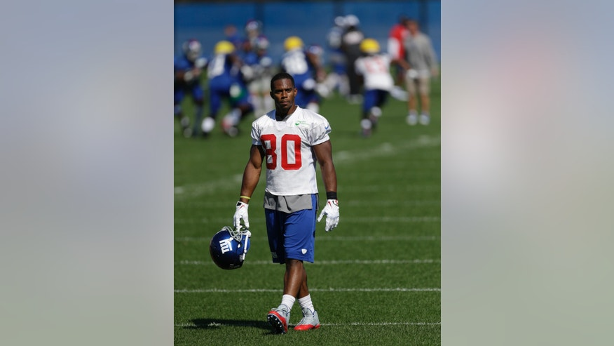 New York Giants wide receiver Victor Cruz walks on the field during NFL football practice, Wednesday, Oct. 2, 2013, in East Rutherford, N.J. (AP Photo/Julio Cortez)