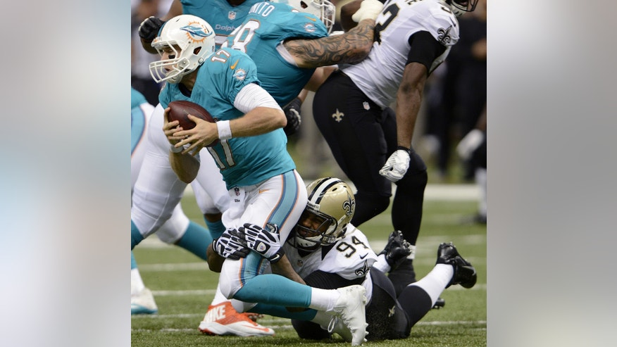 Miami Dolphins quarterback Ryan Tannehill (17) is sacked by New Orleans Saints defensive end Cameron Jordan (94) in the second half of an NFL football game in New Orleans, Monday, Sept. 30, 2013. (AP Photo/Bill Feig)