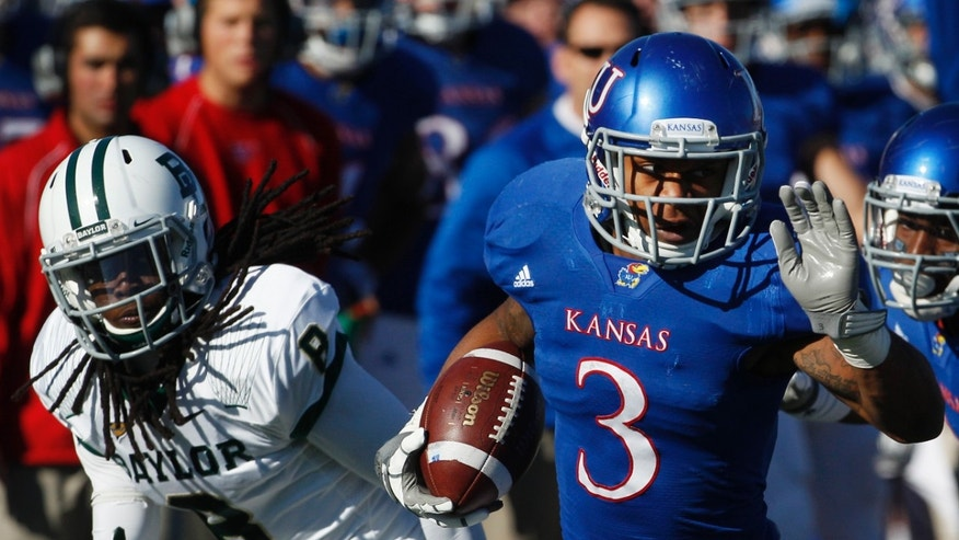FILE - In this Nov. 12, 2011, file photo, Kansas running back Darrian Miller (3) breaks away from Baylor safety K.J. Morton (8) during the first half of an NCAA college football game in Lawrence, Kan. Dexter McDonald and Miller are grateful to have a second chance. Kicked off the Kansas football team by coach Charlie Weis, they spent last season at a junior college, and have now worked their way back into the Jayhawks' program.(AP Photo/Orlin Wagner, File)