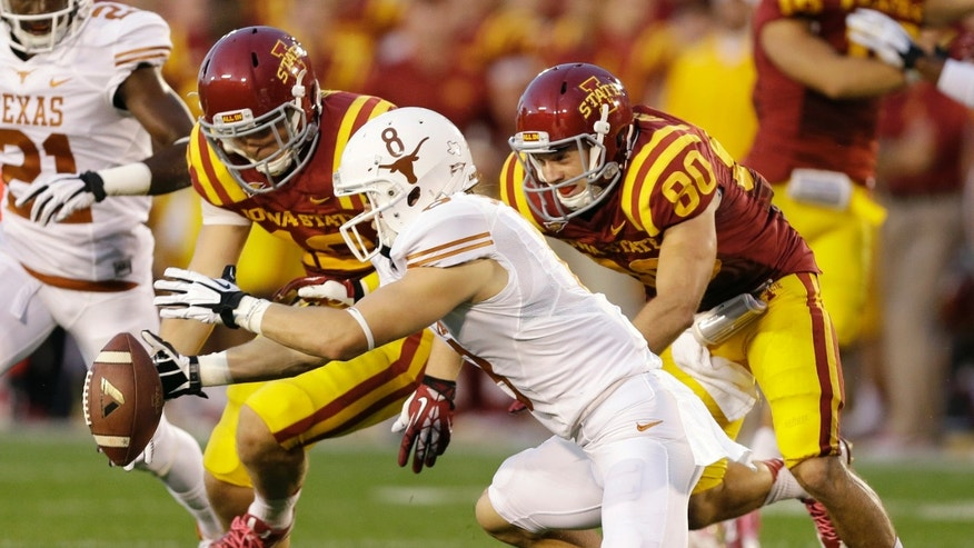 Texas wide receiver Jaxon Shipley, center, recovers a fumbled punt in front of Iowa State's Wes Boyer, left, and Justin Coleman, right, during the first half of an NCAA college football game, Thursday, Oct. 3, 2013, in Ames, Iowa. (AP Photo/Charlie Neibergall)