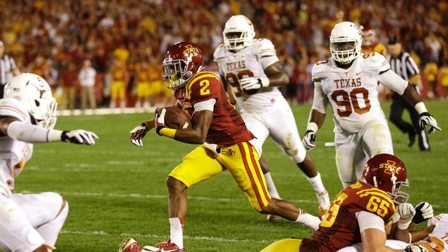 Iowa State's Aaron Wimberly (2) runs to the end zone past Texas defenders during an 11-yard touchdown reception in the first half of an NCAA college football game, Thursday, Oct. 3, 2013, in Ames, Iowa. (AP Photo/Charlie Neibergall)