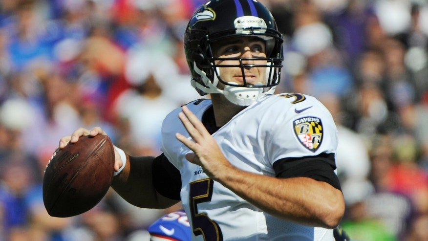 Baltimore Ravens quarterback Joe Flacco (5) passes against the Buffalo Bills during the first half of an NFL football game on Sunday, Sept. 29, 2013, in Orchard Park, N.Y. (AP Photo/Gary Wiepert)