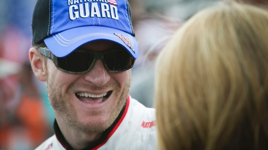Dale Earnhardt Jr. smiles as he waits for the start of the NASCAR Sprint Cup Series auto race Sunday, Sept. 29, 2013, in Dover, Del. (AP Photo/The News-Journal, Suchat Pederson) NO SALES