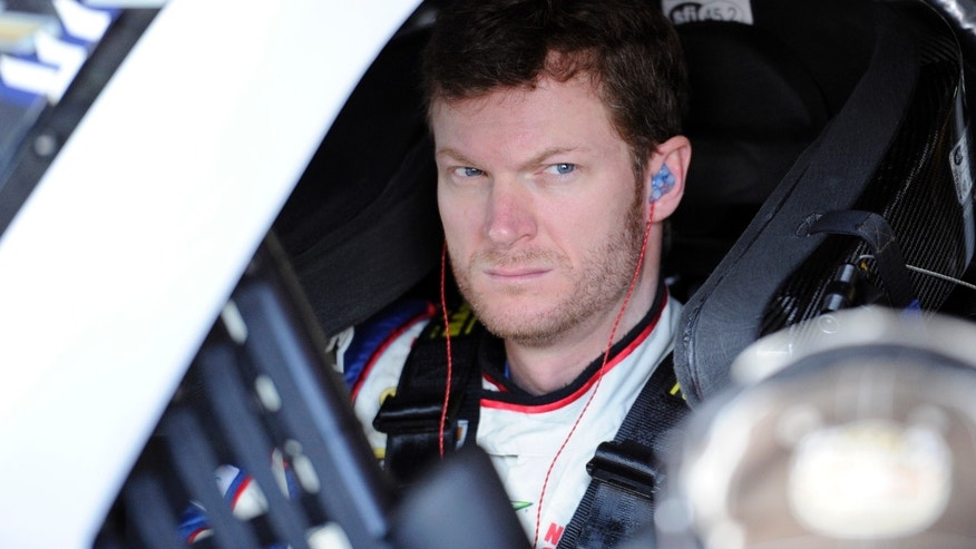 Dale Earnhardt Jr. looks on before practice for Sunday's NASCAR Sprint Cup series auto race, Saturday, Sept. 28, 2013, at Dover International Speedway in Dover, Del. (AP Photo/Nick Wass)