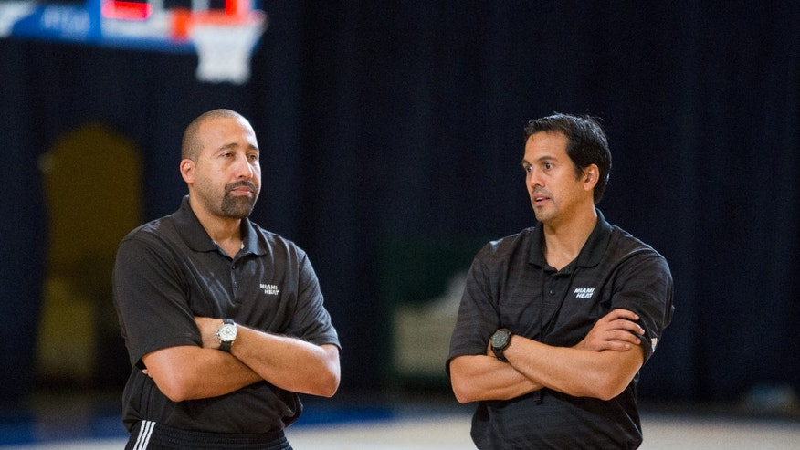 Miami Heat head coach Erik Spoelstra, right, and his assistant David Fizdale talk after training at the Atlantis resort on Paradise Island, Bahamas, Wednesday, Oct. 2, 2013. The two-time defending NBA champions are holding a one week training camp at the resort. (AP Photo/Bahamas Visual Services, Dante Carrer)