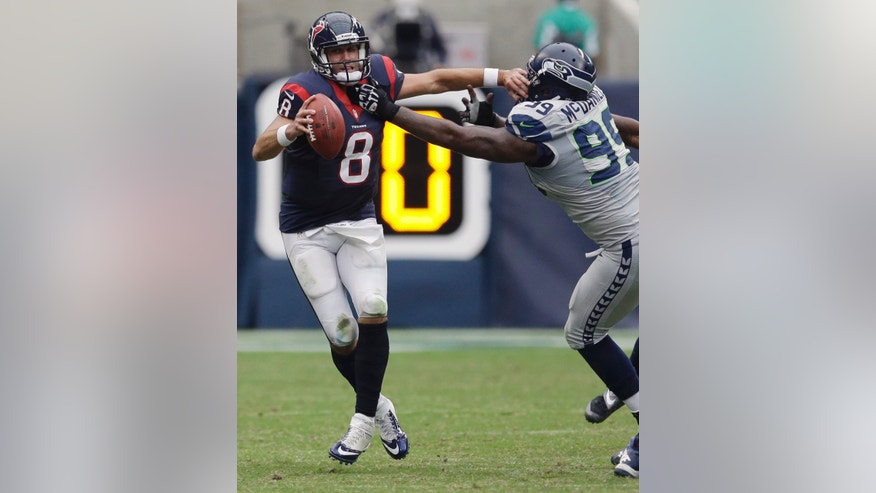 Houston Texans' Matt Schaub (8) is pressured by Seattle Seahawks' Tony McDaniel (99) during the fourth quarter an NFL football game on Sunday, Sept. 29, 2013, in Houston. (AP Photo/David J. Phillip)