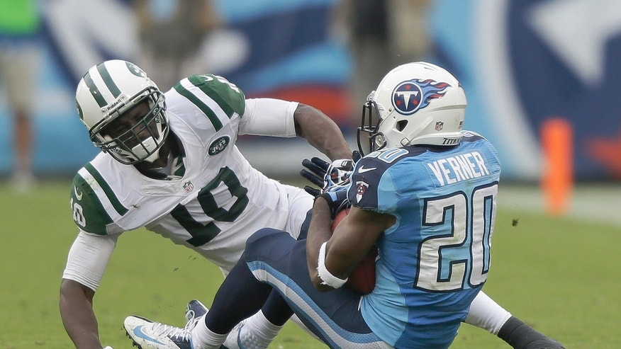 Tennessee Titans cornerback Alterraun Verner (20) intercepts a pass intended for New York Jets wide receiver Santonio Holmes (10) in the second quarter of an NFL football game on Sunday, Sept. 29, 2013, in Nashville, Tenn. (AP Photo/Wade Payne)