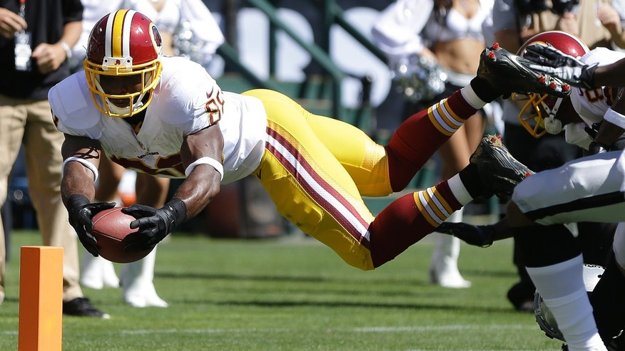 Washington Redskins wide receiver Pierre Garcon (88) dives for the goal line, but goes out of bounds during the second quarter of an NFL football game against the Oakland Raiders in Oakland, Calif., Sunday, Sept. 29, 2013. (AP Photo/Ben Margot)