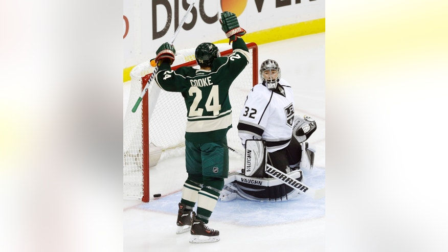 Minnesota Wild's Matt Cooke (24) celebrates his goal against Los Angeles Kings goalie Jonathan Quick during the first period of an NHL hockey game, Thursday, Oct. 3, 2013, in St. Paul, Minn. (AP Photo/Jim Mone)