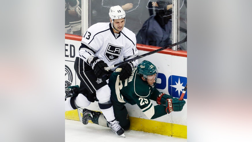 Minnesota Wild's Jonas Brodin (25) gets slammed into the boards by Los Angeles Kings' Kyle Clifford (13) during the first period of an NHL hockey game, Thursday, Oct. 3, 2013, in St. Paul, Minn. (AP Photo/Jim Mone)