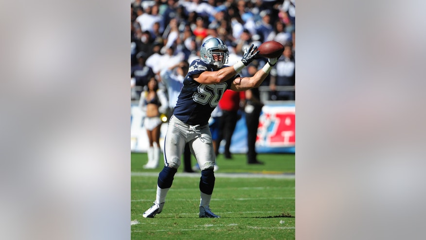 Dallas Cowboys middle linebacker Sean Lee intercepts a pass for a touchdown against the San Diego Chargers during the first half of an NFL football game Sunday, Sept. 29, 2013, in San Diego. (AP Photo/Denis Poroy)