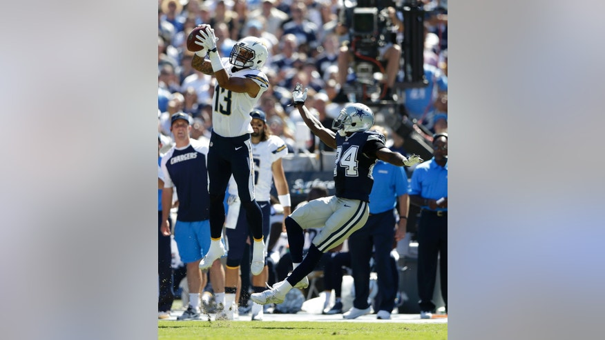 San Diego Chargers wide receiver Keenan Allen catches a pass in front on Dallas Cowboys cornerback Morris Claiborne during the first half of an NFL football game Sunday, Sept. 29, 2013, in San Diego. (AP Photo/Gregory Bull)