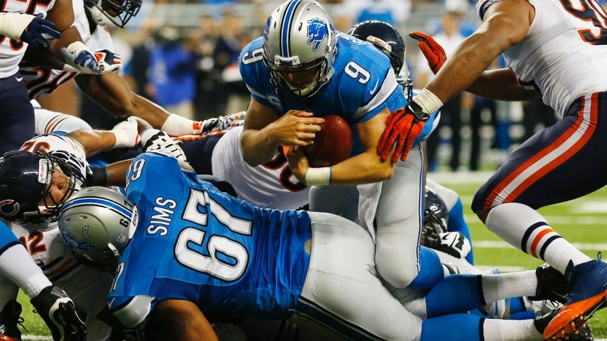 Detroit Lions quarterback Matthew Stafford (9) falls over the goal line for a touchdown after recovering his own fumble during the second quarter of an NFL football game against the Chicago Bears at Ford Field in Detroit, Sunday, Sept. 29, 2013. (AP Photo/Paul Sancya)