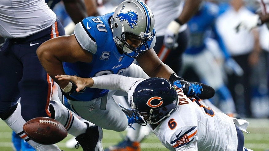 In this Sept. 29, 2013 photo, Detroit Lions defensive tackle Ndamukong Suh (90) hits Chicago Bears quarterback Jay Cutler (6) causing a fumble that defensive tackle Nick Fairley recovered for a touchdown during the third quarter of an NFL football game at Ford Field in Detroit. Suh was drawing attention for all the right seasons Sunday, when he had two sacks and forced a fumble to help the Detroit Lions to a convincing 40-32 win over the Chicago Bears.  (AP Photo/Paul Sancya)