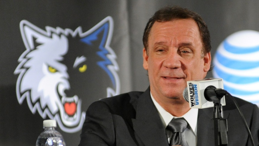 In this photo taken May 3, 2013, former Minnesota Timberwolves head coach Flip Saunders is introduced as the Timberwolves' new president for basketball operations during an NBA basketball news conference in Minneapolis.  It's seems like an odd pairing at first. Saunders, the slick, media savvy executive who wears designer suits. Rick Adelman, the curmudgeonly coach, who dresses in all black every day and has no interest in small talk. Together, they represent this long-suffering franchise's best chance to become relevant again. (AP Photo/The Star Tribune,  Richard Sennott)  MANDATORY CREDIT; ST. PAUL PIONEER PRESS OUT; MAGS OUT; TWIN CITIES TV OUT