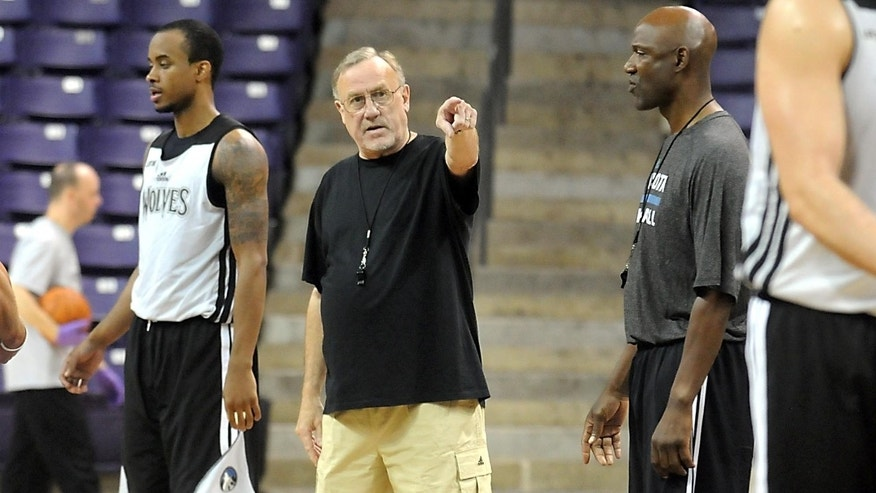 Minnesota Timberwolves coach Rick Adelman talks to his team during the first day of NBA basketball training camp Tuesday, Oct. 1, 2013, in Mankato, Minn. (AP Photo/Mankato Free Press, Pat Christman)