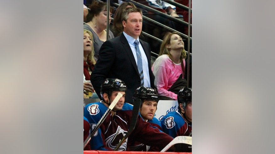 Colorado Avalanche head coach Patrick Roy, top center, directs his team against the Anaheim Ducks in the second period of an NHL hockey game in Denver, Wednesday, Oct. 2, 2013. (AP Photo/David Zalubowski)