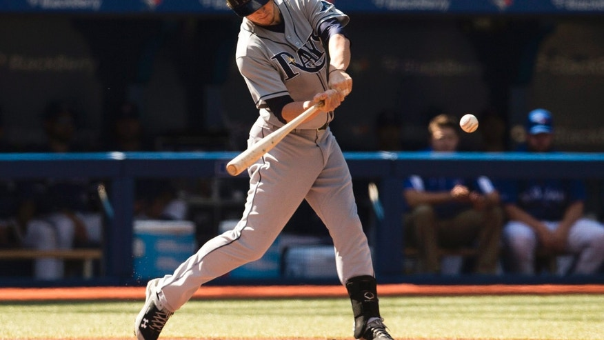 Tampa Bay Rays' Wil Myers hits an RBI single against the Toronto Blue Jays during the first inning of a baseball game in Toronto, Saturday, Sept. 28, 2013. (AP Photo/The Canadian Press, Mark Blinch)