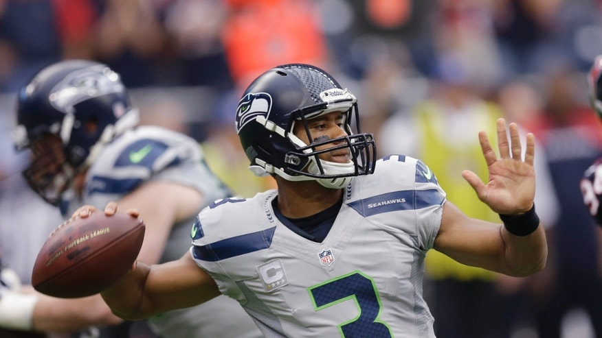 Seattle Seahawks' Russell Wilson throws against the Houston Texans during the first quarter an NFL football game Sunday, Sept. 29, 2013, in Houston. (AP Photo/David J. Phillip)