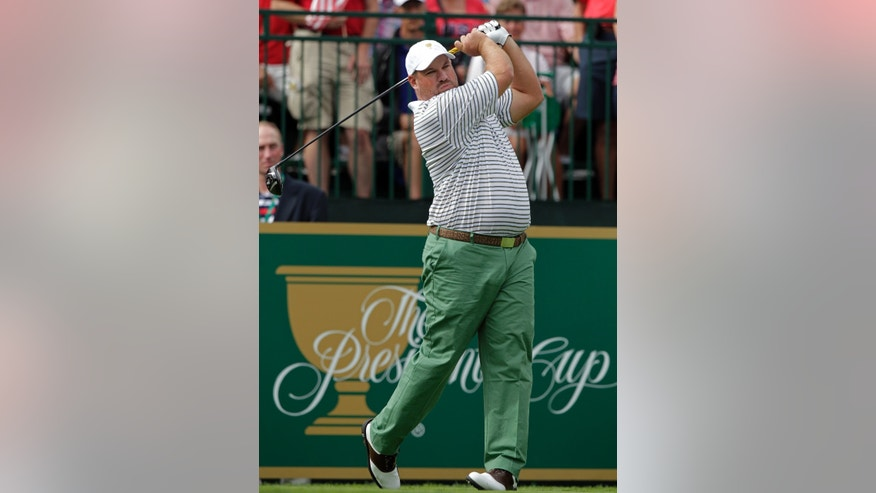 International team player Brendon de Jonge, of Zimbabwe, tees off on the first hole during a four-ball match against the United States at the Presidents Cup golf tournament at Muirfield Village Golf Club Thursday, Oct. 3, 2013, in Dublin, Ohio. (AP Photo/Jay LaPrete)