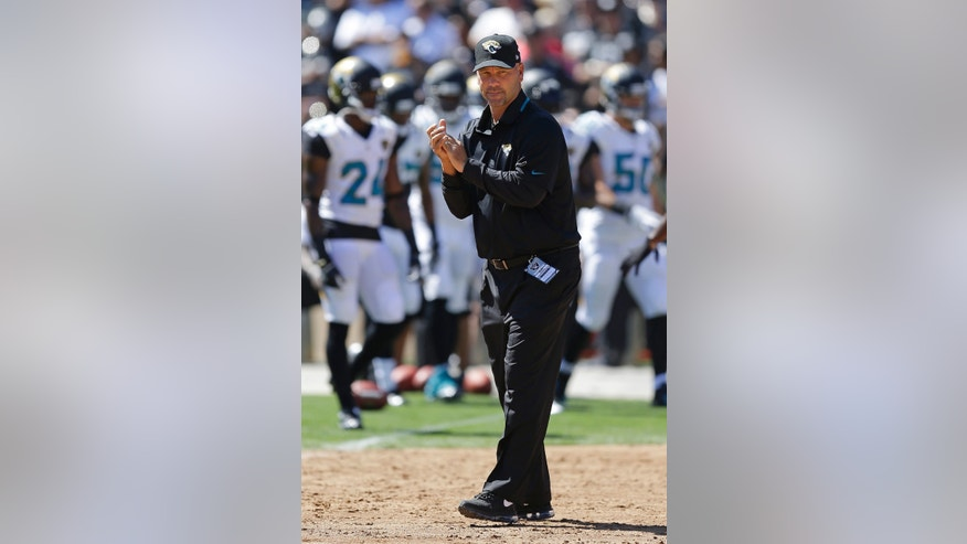 ADVANCE FOR WEEKEND EDITIONS, OCT. 5-6 - FILE - In this Sept. 15, 2013, file photo, Jacksonville Jaguars head coach Gus Bradley watches as players warms up before an NFL football game against the Oakland Raiders in Oakland, Calif. Here's the Good, Bad and Ugly from the first quarter of the NFL season. From Peyton Manning's unstoppable offense to Eli Manning's invisible pass protection. From Kansas City's resurgence in the standings to Tampa Bay's insurgence in the locker room. From Seattle's stingy defense to Jacksonville's potential 0-16 threat. (AP Photo/Ben Margot)