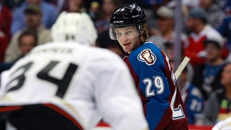 Colorado Avalanche rookie center Nathan MacKinnon (29) jokes with teammates as he steps into the faceoff circle against the Anaheim Ducks in the first period of an NHL hockey game in Denver, Wednesday, Oct. 2, 2013. (AP Photo/David Zalubowski)