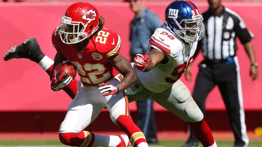 Kansas City Chiefs kick returner Dexter McCluster (22) gets past New York Giants' Damontre Moore (98) during the second half of an NFL football game at Arrowhead Stadium in Kansas City, Mo., Sunday, Sept. 29, 2013. McCluster scored a touchdown on the play. (AP Photo/Ed Zurga)