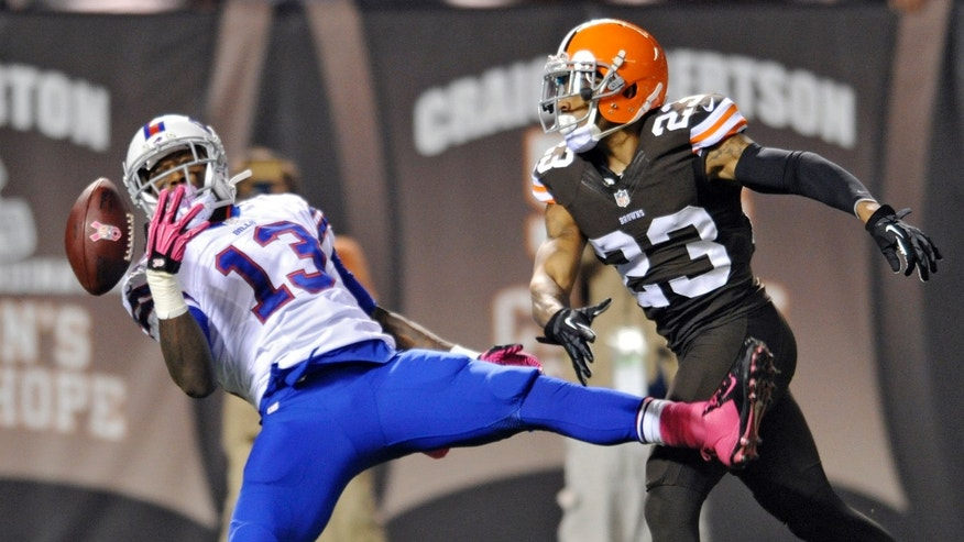 Cleveland Browns cornerback Joe Haden (23) breaks up a pass for Buffalo Bills wide receiver Stevie Johnson (13), but is called for pass interference in the first quarter of an NFL football game Thursday, Oct. 3, 2013, in Cleveland. (AP Photo/David Richard)