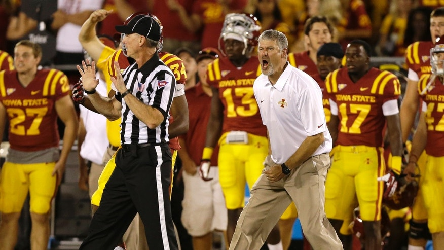 Iowa State coach Paul Rhoads, right, reacts to a call against his team during the second half of an NCAA college football game against Texas, Thursday, Oct. 3, 2013, in Ames, Iowa. Texas won 31-30. (AP Photo/Charlie Neibergall)