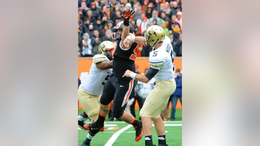 Oregon State's Mana Rosa (93) deflects a throw by Colorado quarterback Connor Wood (5) in the first half of an NCAA college football game on Saturday, Sept 28, 2013, in Corvallis, Ore. (AP Photo/Greg Wahl-Stephens)