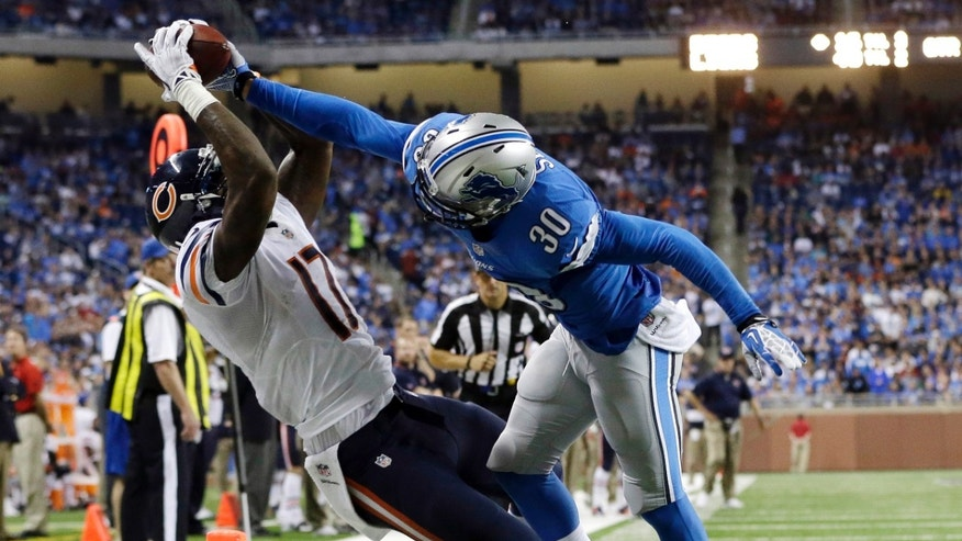 Chicago Bears wide receiver Alshon Jeffery (17), defended by Detroit Lions cornerback Darius Slay (30), scores on a 14-yard reception during the fourth quarter of an NFL football game at Ford Field in Detroit, Sunday, Sept. 29, 2013. (AP Photo/Paul Sancya)