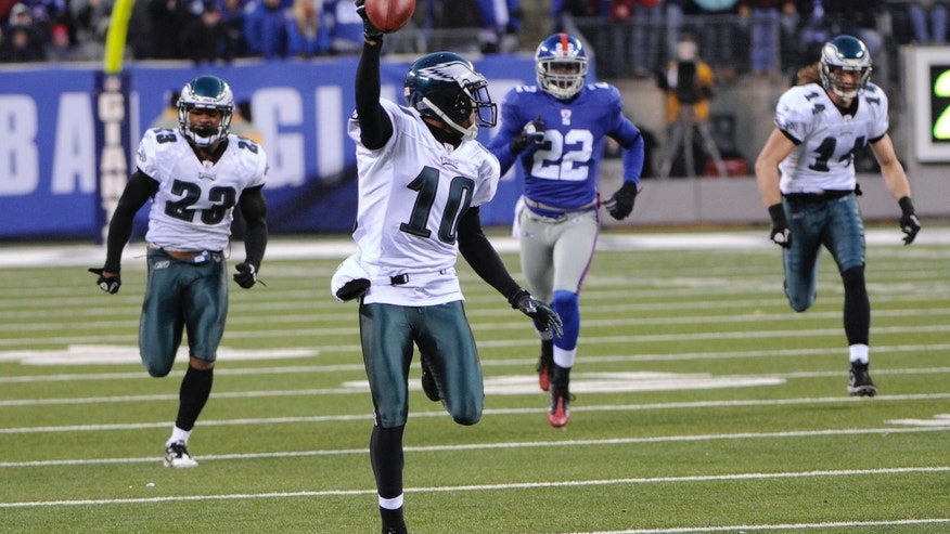 FILE - In this Dec. 19, 2010, file photo, Philadelphia Eagles' DeSean Jackson returns a punt for a touchdown during the fourth quarter of the NFL football game against the New York Giants in East Rutherford, N.J. The Eagles won 38-31. The Eagles have enjoyed some of their greatest moments on the road against the Giants. Chip Kelly, the Eagles' coach, certainly doesn't need a refresher course before Sunday's game between the two struggling teams. He knows Philadelphia (1-3) and New York (0-4) go back a long way. (AP Photo/Bill Kostroun, File)