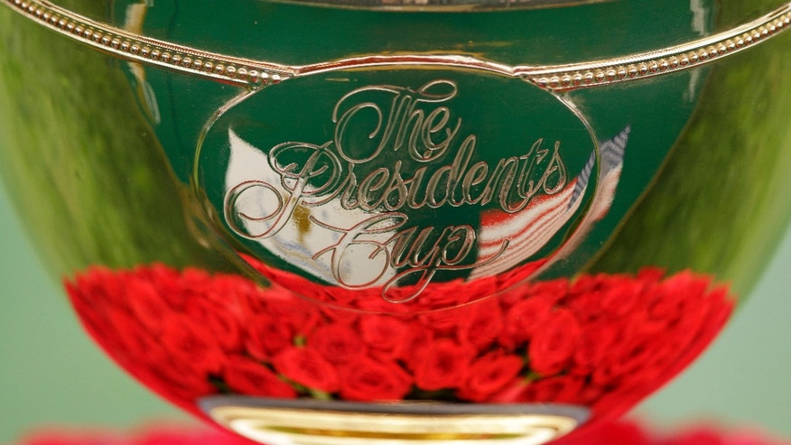 This photo shows the Presidents Cup before the start of the foursome matches at the Presidents Cup golf tournament at Muirfield Village Golf Club, Friday, Oct. 4, 2013, in Dublin, Ohio. (AP Photo/Darron Cummings)