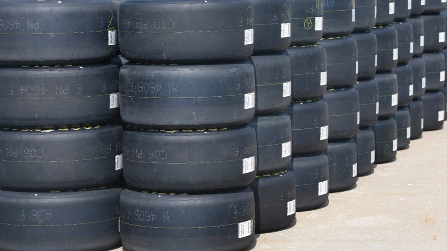 Goodyear racing tires await distribution to NASCAR teams at Kansas Speedway in Kansas City, Kan., Thursday, Oct. 3, 2013. Teams are testing tires on the recently re-surfaced track. (AP Photo/Orlin Wagner)