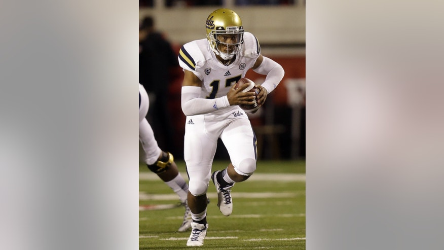 UCLA quarterback Brett Hundley (17) carries the ball in the first quarter during an NCAA college football game against Utah, Thursday, Oct. 3, 2013, in Salt Lake City. (AP Photo/Rick Bowmer)
