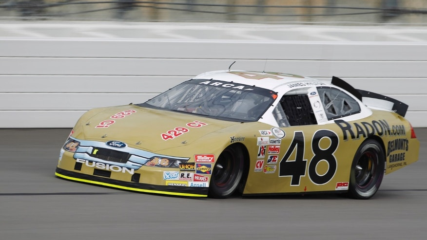 ARCA driver James Hylton takes a lap during practice at Kansas Speedway in Kansas City, Kan., Friday, Oct. 4, 2013. The 79-year-old will retire following Friday night's ARCA Kansas Lottery 98.9 race. (AP Photo/Colin E. Braley)