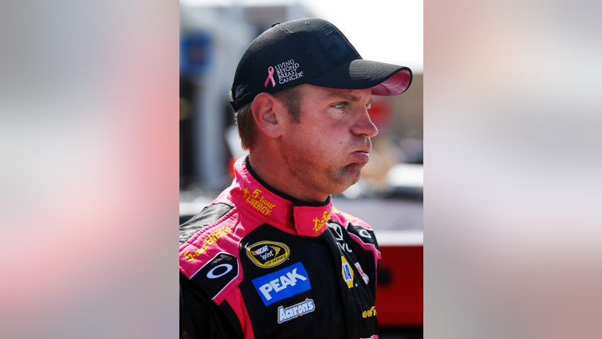 Driver Clint Bowyer exhales following practice for Sunday's NASCAR Sprint Cup series auto race at Kansas Speedway in Kansas City, Kan., Friday, Oct. 4, 2013. (AP Photo/Orlin Wagner)