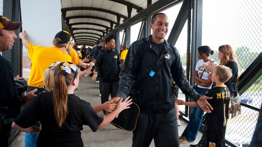 Missouri quarterback James Franklin is greeted by fans as he walks to the stadium before the start of their NCAA college football game against Arkansas State Saturday, Sept. 28, 2013, in Columbia, Mo. (AP Photo/L.G. Patterson)