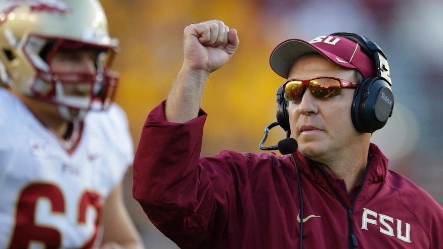 Florida State head coach Jimbo Fisher pumps his fist after his team scored a touchdown during the second half of an NCAA college football game against Boston College in Boston, Mass., Saturday, Sept. 28, 2013. Florida State defeated Boston College 48-34. (AP Photo/Stephan Savoia)