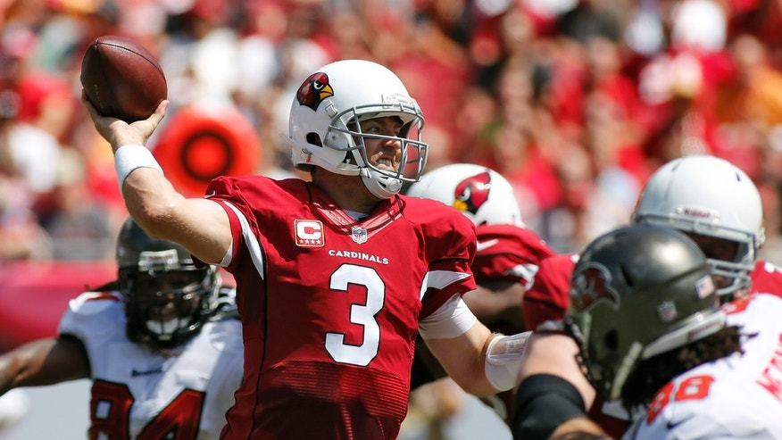 Arizona Cardinals quarterback Carson Palmer (3) throws a pass as he is pressured by Tampa Bay Buccaneers defensive end Steven Means (96), right,  during the first quarter of an NFL football game Sunday, Sept. 29, 2013, in Tampa, Fla. (AP Photo/Reinhold Matay)