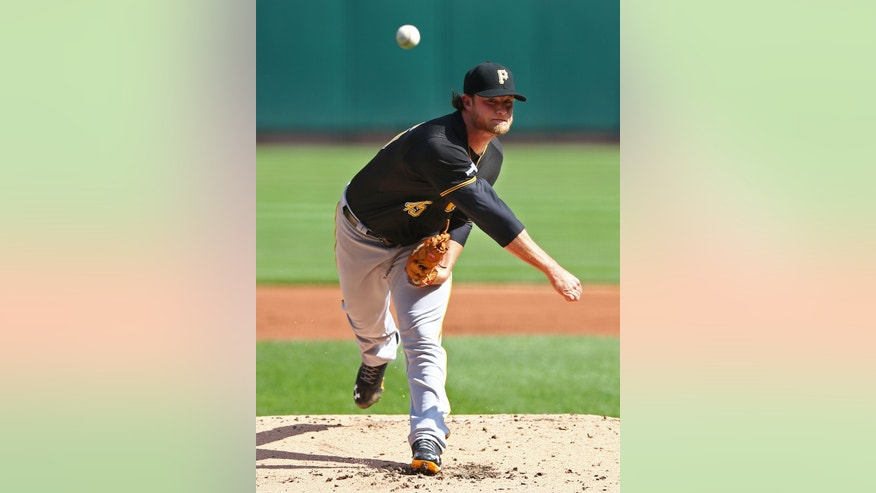 Pittsburgh Pirates pitcher Gerrit Cole throws against the St. Louis Cardinals in the first inning of Game 2 of baseball's National League division series on Thursday, Oct. 3, 2013, in St. Louis. (AP Photo/Elsa, Pool)