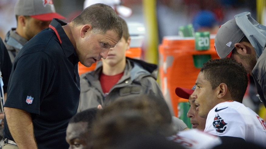 FILE - In this Sept. 15, 2013 file photo, Tampa Bay Buccaneers head coach Greg Schiano, left, talks to quarterback Josh Freeman (5) during the second quarter of an NFL football game against the Tampa Bay Buccaneers, in Tampa, Fla.  The Buccaneers have released Freeman, Thursday, Oct. 3. 2013, one week after benching the fifth-year pro in favor of rookie Mike Glennon.  (AP Photo/Phelan M. Ebenhack, File)