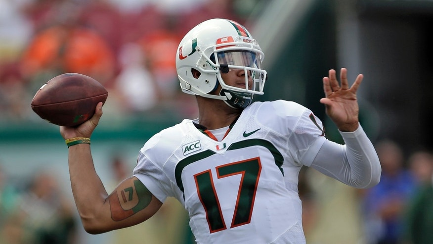 Miami quarterback Stephen Morris (17) fires a pass against South Florida during the second quarter of an NCAA college football game Saturday, Sept. 28, 2013, in Tampa, Fla. (AP Photo/Chris O'Meara)