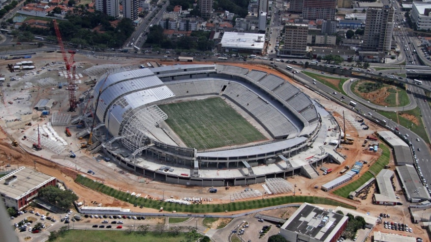 This Sept. 2013 photo released by Portal da Copa shows an aerial view of the Arena das Dunas stadium in Natal, Rio Grande do Norte state, Brazil. With less than three months to go before the December deadline established by FIFA for the delivery of the its World Cup soccer stadiums, Brazil is working at full steam to have all venues ready in time. (AP Photo/Caninde Soares, Portal da Copa)