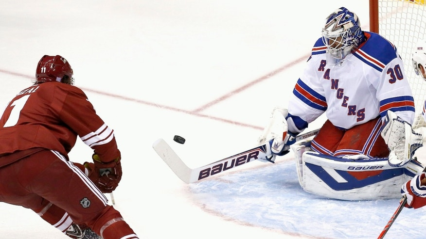 New York Rangers' Henrik Lundqvist (30), of Sweden, makes a save on a shot by Phoenix Coyotes' Martin Hanzal (11), of the Czech Republic, in the first period during an NHL hockey game on Thursday, Oct. 3, 2013, in Glendale, Ariz. (AP Photo/Ross D. Franklin)