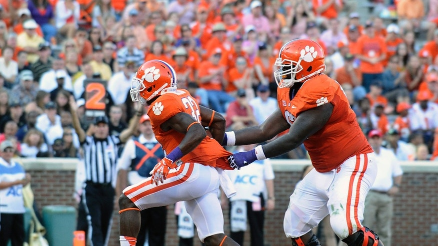 Clemson running back C.J. Davidson (32) celebrates his touchdown with teammate Kalon Davis (67) during the second half of an NCAA college football game against Wake Forest, Saturday, Sept. 28, 2013, in Clemson, S.C. Clemson won 56-7. (AP Photo/Rainier Ehrhardt)