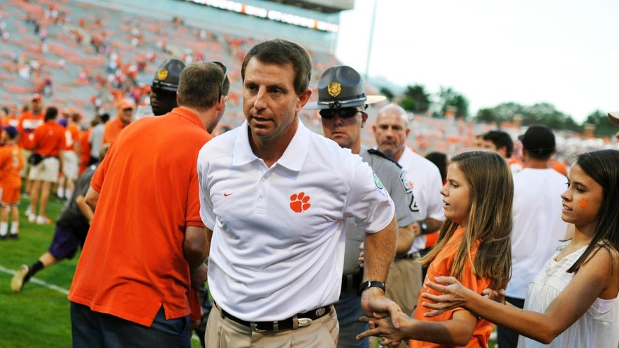 Clemson head coach Dabo Swinney leaves the field after defeating Wake Forest 56-7 in an NCAA college football game, Saturday, Sept. 28, 2013, in Clemson, S.C. (AP Photo/Rainier Ehrhardt)