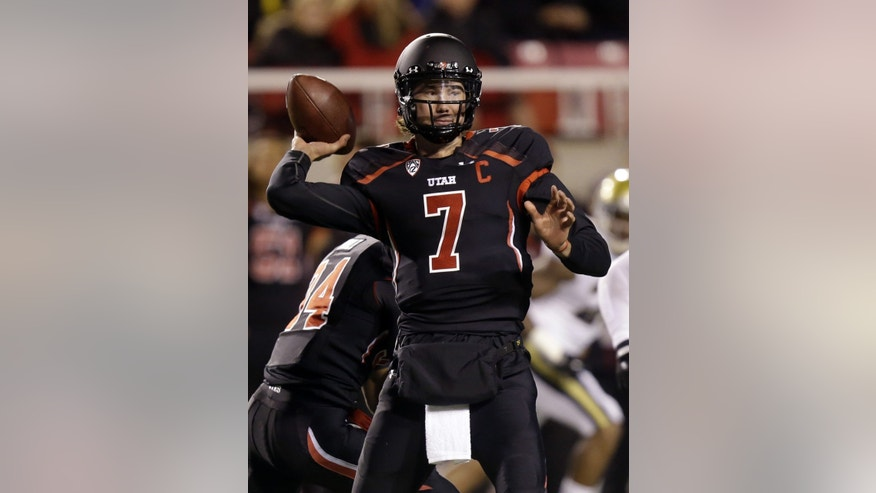 Utah quarterback Travis Wilson (7) passes the ball in the first quarter during an NCAA college football game against UCLA, Thursday, Oct. 3, 2013, in Salt Lake City. (AP Photo/Rick Bowmer)