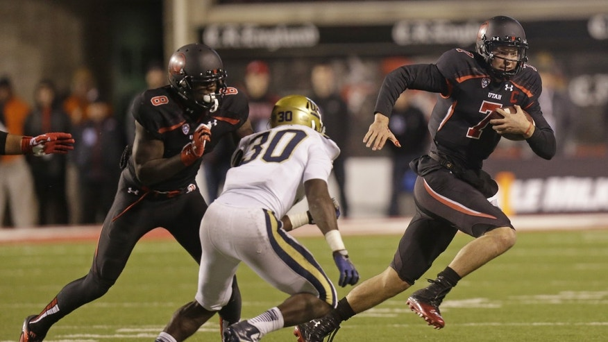 UCLA linebacker Myles Jack (30) pursues Utah quarterback Travis Wilson (7) in the second half during an NCAA college football game Thursday, Oct. 3, 2013, in Salt Lake City.  UCLA won 34-27.  (AP Photo/Rick Bowmer)
