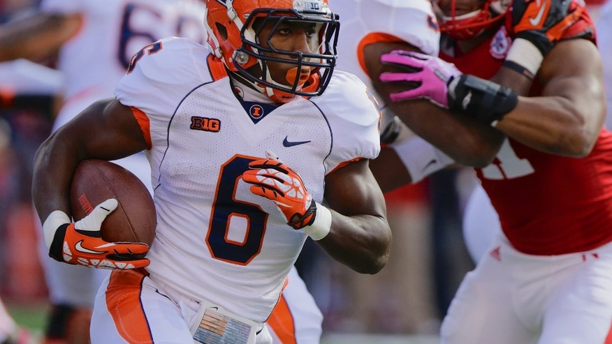 Illinois running back Josh Ferguson (6) carries the ball in the first half of an NCAA college football game against Nebraska in Lincoln, Neb., Saturday, Oct. 5, 2013. (AP Photo/Nati Harnik)
